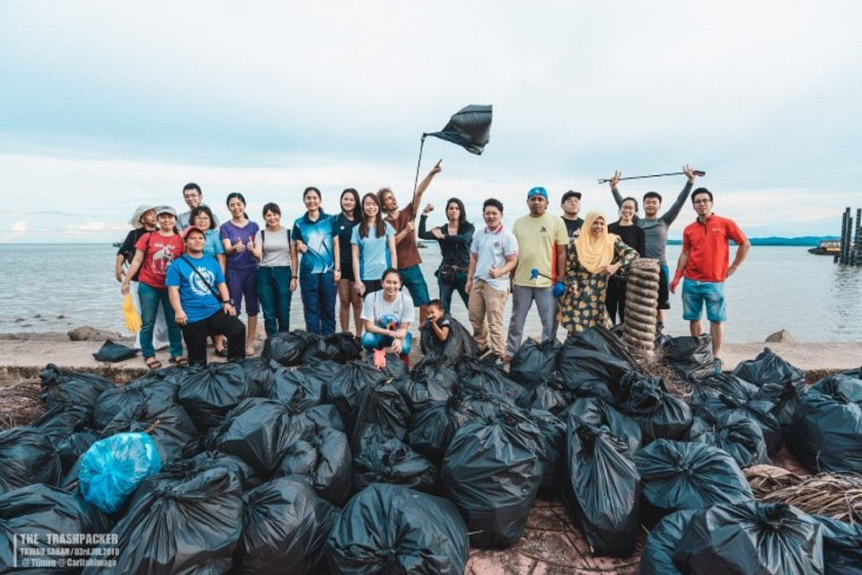 Towards 100,000 full garbage bags together